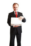 Businessman in black suit surprised with a gift Royalty Free Stock Photo