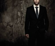 Businessman in black suit Royalty Free Stock Images