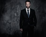 Businessman in black suit Stock Images