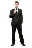 Businessman in black suit on white. Stock Photo