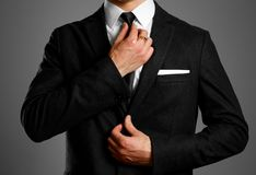Businessman in a black suit, white shirt and tie. Studio shooting stock photos