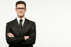 Businessman in black suit on white. Royalty Free Stock Photo