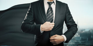 Businessman with black superhero cape stock photo