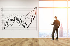 Businessman and black and white graph Royalty Free Stock Images