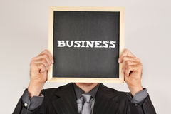 Businessman with a blackboard Stock Images