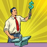 Businessman blacksmith forges money on the anvil Stock Images