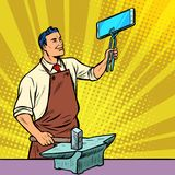 Businessman blacksmith forges smartphone on anvil Stock Images