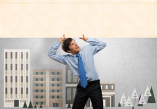 Businessman with blank banner Stock Photos