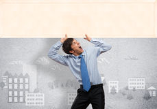 Businessman with blank banner Royalty Free Stock Images