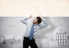 Businessman with blank banner Royalty Free Stock Photo