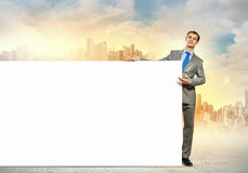 Businessman with blank banner Royalty Free Stock Photography