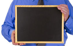 Businessman with blank Blackboard Stock Image