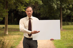 Businessman with blank board Stock Images