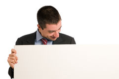 Businessman with blank board Stock Photos