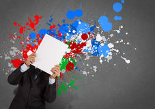 Businessman with blank book and splash colors choice Stock Photography