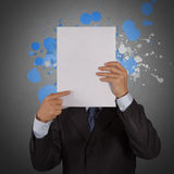 Businessman with blank book and splash colors choice Royalty Free Stock Image