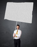 Businessman with blank booklet paper Stock Photo