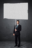 Businessman with blank booklet paper Stock Images