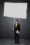Businessman with blank booklet paper Stock Photos