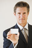 Businessman with blank business card Stock Photography