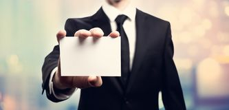 Businessman with a blank business card Royalty Free Stock Photography