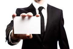 Businessman with a blank business card on a white background Royalty Free Stock Images