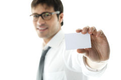 Businessman with blank businesscard. Focus on foreground. Copy space for your own text Stock Photography