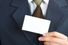 Businessman with blank card Royalty Free Stock Photos
