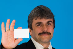 Businessman with blank card Stock Photos