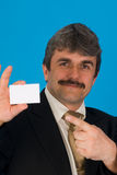 Businessman with blank card Stock Images