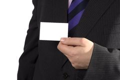 A businessman with a blank card. A businessman showing you a blank card stock image