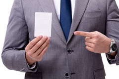 The businessman with blank card isolated on white background Stock Images