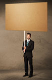 Businessman with blank cardboard Royalty Free Stock Images