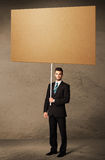 Businessman with blank cardboard Stock Photography