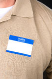 Businessman with a blank nametag Royalty Free Stock Images