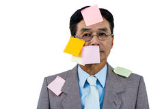 Businessman with blank note over his face Stock Images