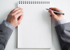 Businessman and a Blank Notepad Stock Photos