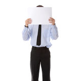 Businessman with a blank paper in his face Stock Images