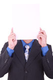 A businessman with a blank paper in his face Royalty Free Stock Images