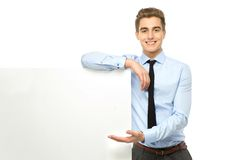 Businessman with blank poster Stock Photos