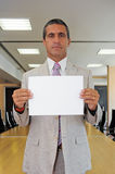 Businessman with blank sheet Stock Photography