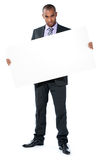 Businessman with blank sign Stock Photography