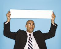 Businessman with blank sign Stock Images