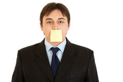 Businessman with blank sticky note on his forehead Stock Photos