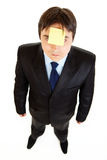Businessman with blank sticky note on his forehead Royalty Free Stock Image