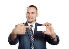 Businessman with blank visit card. Businessman pointing at blank visit card isolated on white background Stock Images