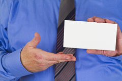 Businessman with blank white card Royalty Free Stock Photography