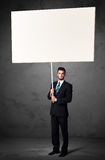Businessman with blank whiteboard Stock Photography
