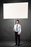Businessman with blank whiteboard Stock Image