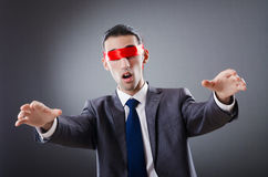 Businessman blinded by  tape Stock Image
